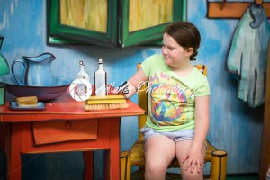 TRENTON, NJ – JUNE 17, 2017: Girl holding camera in playroom art display at Grounds for Sculpture - Kelleher Photography Store