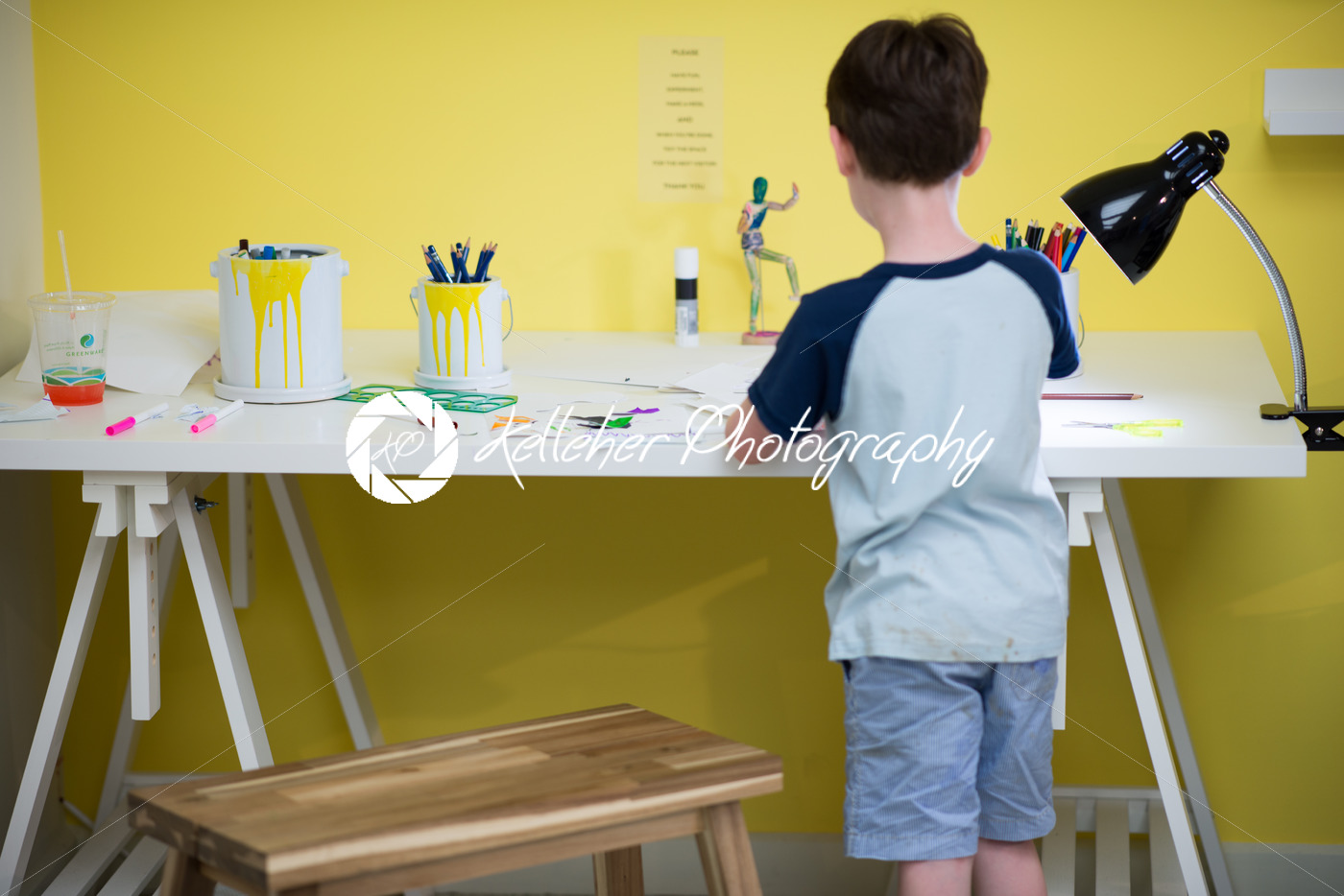 Young boy painting at desk - Kelleher Photography Store