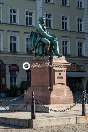Wroclaw, Poland – March 9, 2018: Neoclassical bronze statue of famous Polish writer Alexander Fredro, 1897, by Leonard Marconi in warm sunlight , Market Square - Kelleher Photography Store