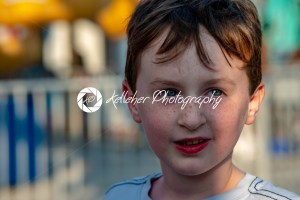 Happy young boy having fun on boardwalk amusement ride - Kelleher Photography Store
