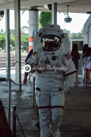 Cape Canaveral, Florida – August 13, 2018: Person in Astronaut space cuit walking by and waving at NASA Kennedy Space Center - Kelleher Photography Store