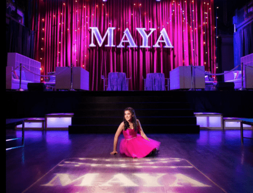 Bat mitzvah girl with name in lights