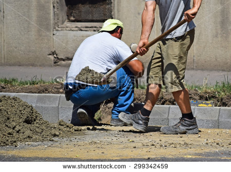 stock-photo-workers-are-working-at-the-road-construction-299342459