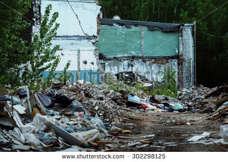 stock-photo-a-garbage-dump-and-a-building-with-ruined-brick-walls-at-background-concept-of-disaster-war-302298125