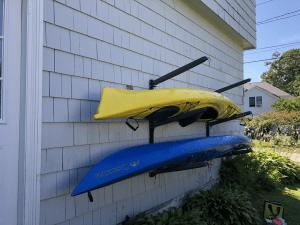 outdoor kayak storage rack wall mount holds 4 kayaks adjustable organizer
