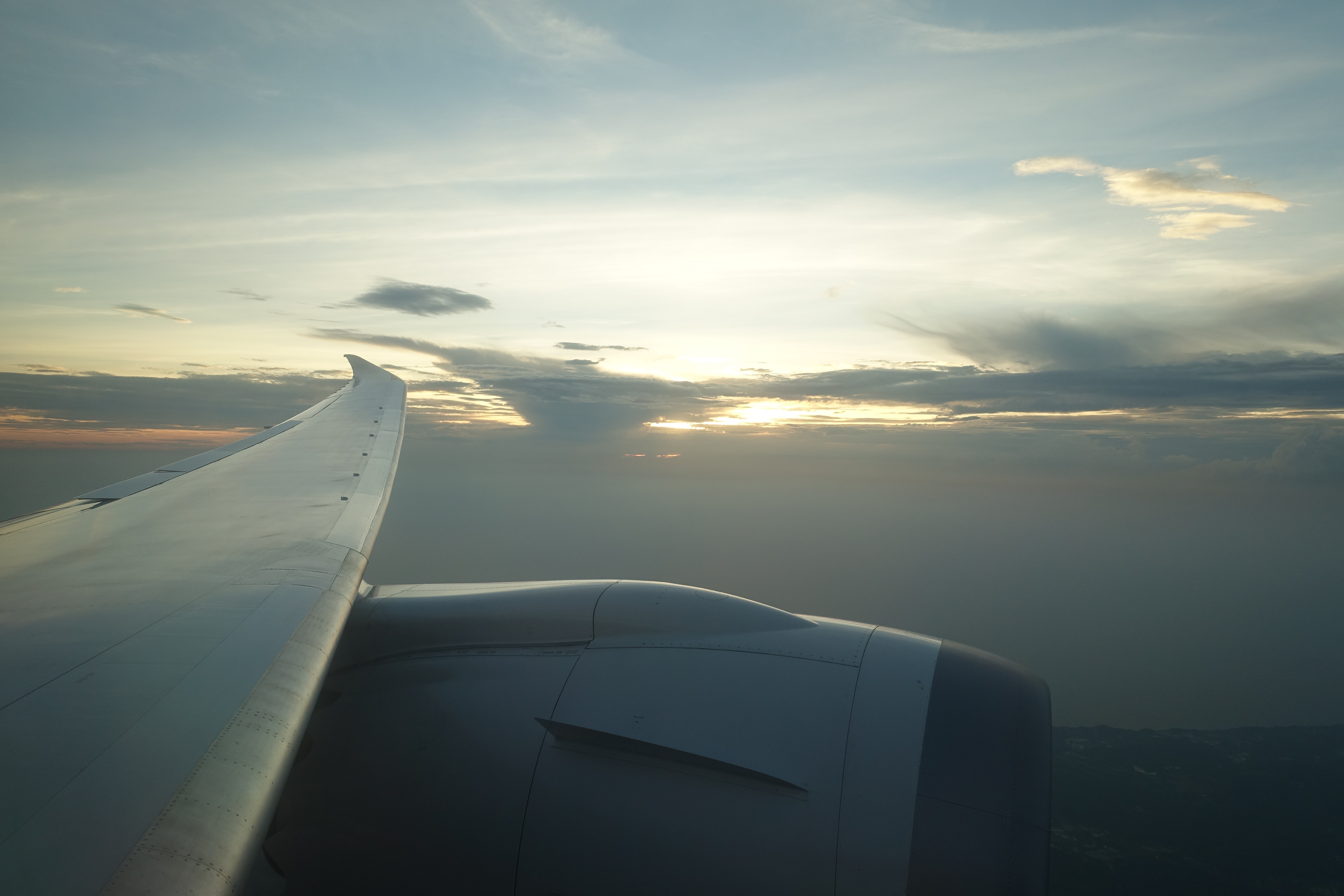 Looking towards the setting sun over the wing
