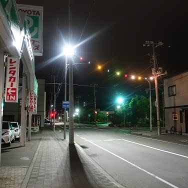 Colourful lights strung up over a street