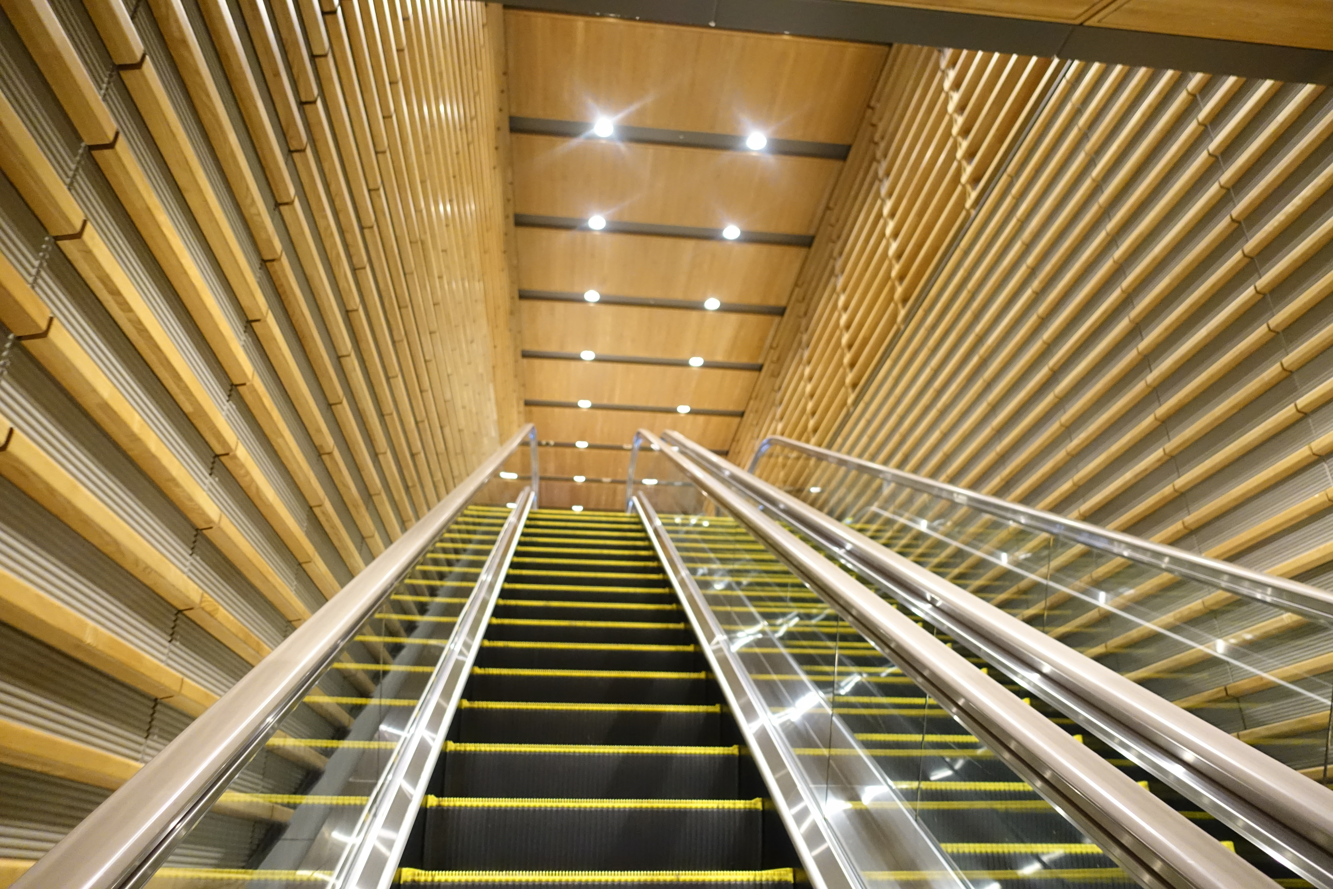 Escalator with wooden slat walls