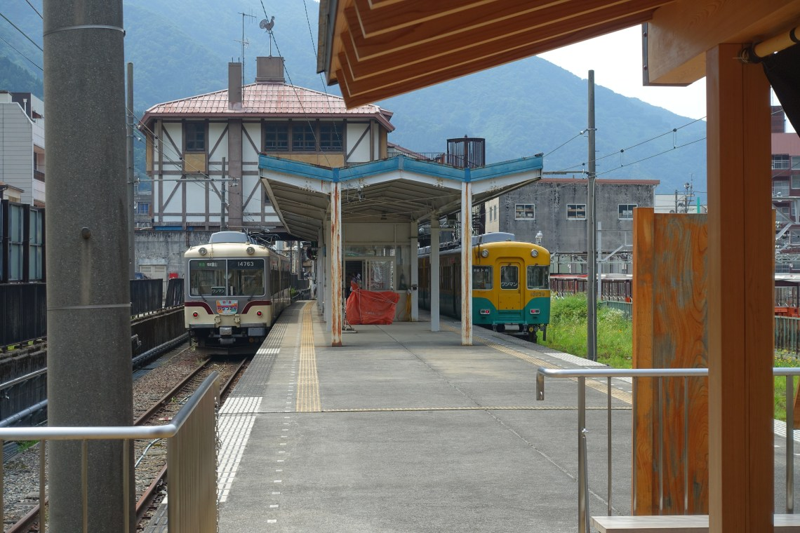 Footbath at Unazuki Onsen Station with two trains