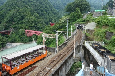 Kurobe Gorge Railway with bridge in the background