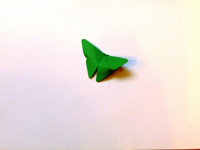 Groene origami vlinder