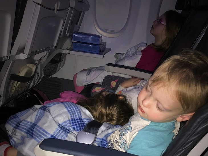 Children asleep on plane