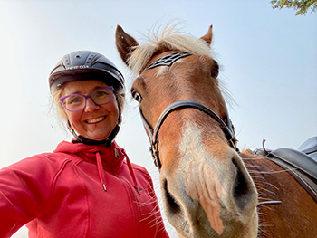 Woman and horse up close