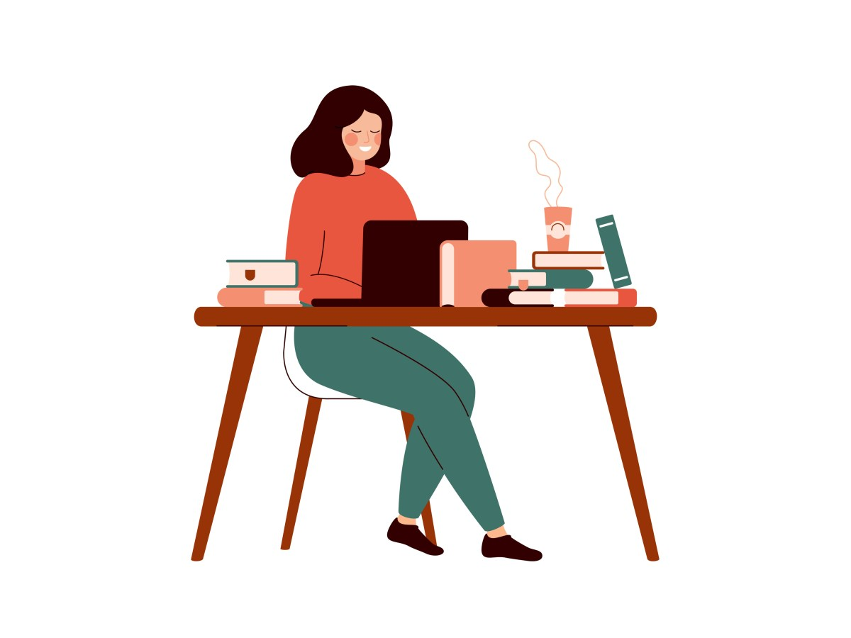 Young woman works at the laptop surrounded with books