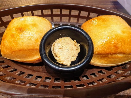 Complimentary dinner bread rolls by Texas Roadhouse