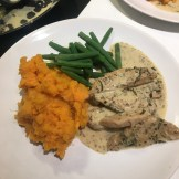 Pork in wine and herb sauce with sweet potato mash