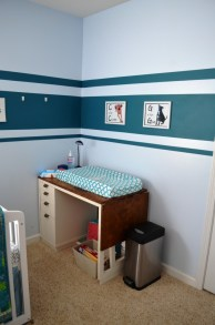 Changing table. Formerly my sewing desk. The drawers are still full of sewing supplies.