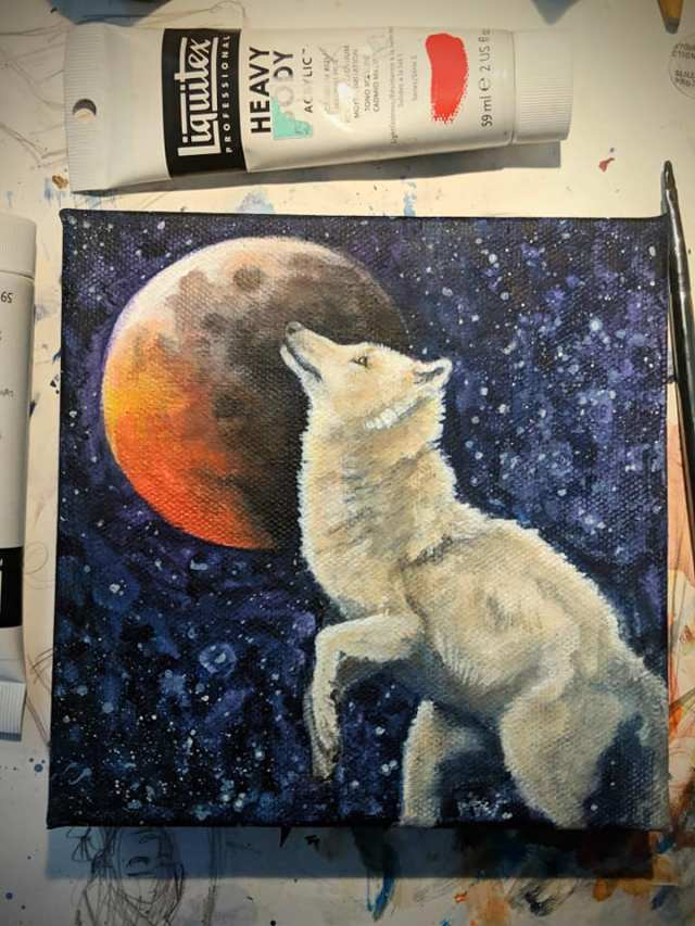 fantasy painting of wolf rearing in front of red moon