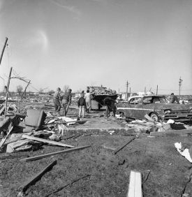 Survivors pick through the wreckage of homes in the Jefferson Place Subdivision.