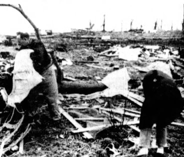 Survivors search the debris of homes at Manitou Beach.