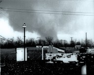 One of two photos of the Cambria tornado, taken by Donald Cox. The photo is facing south from the Rossville area. A large horizontal vortex can be seen developing on the left side of the funnel.