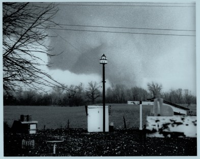 The second of Donald Cox's photos showing the evolution of a large horizontal vortex wrapping around the massive tornado.