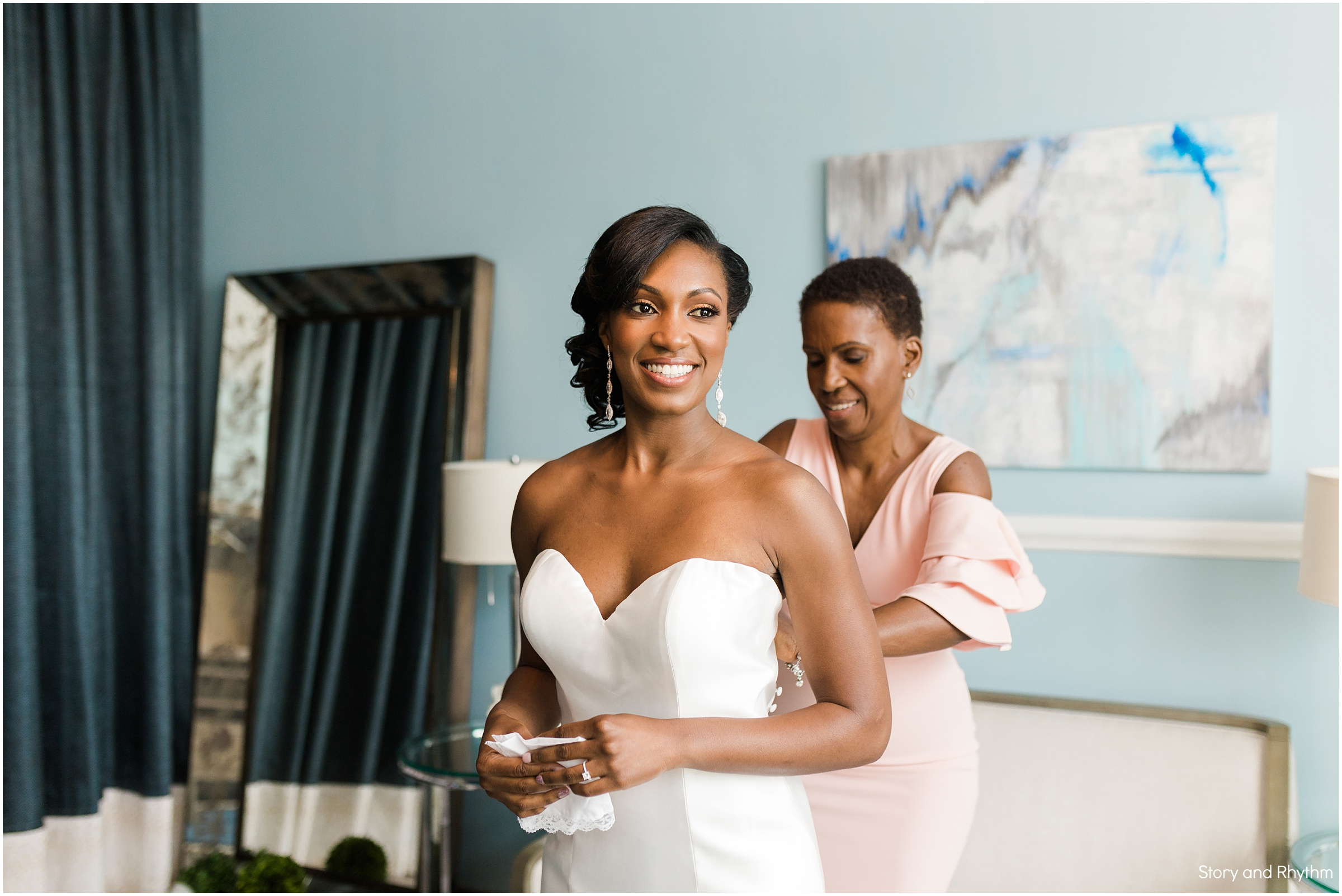 Bride getting dressed at downtown Raleigh wedding
