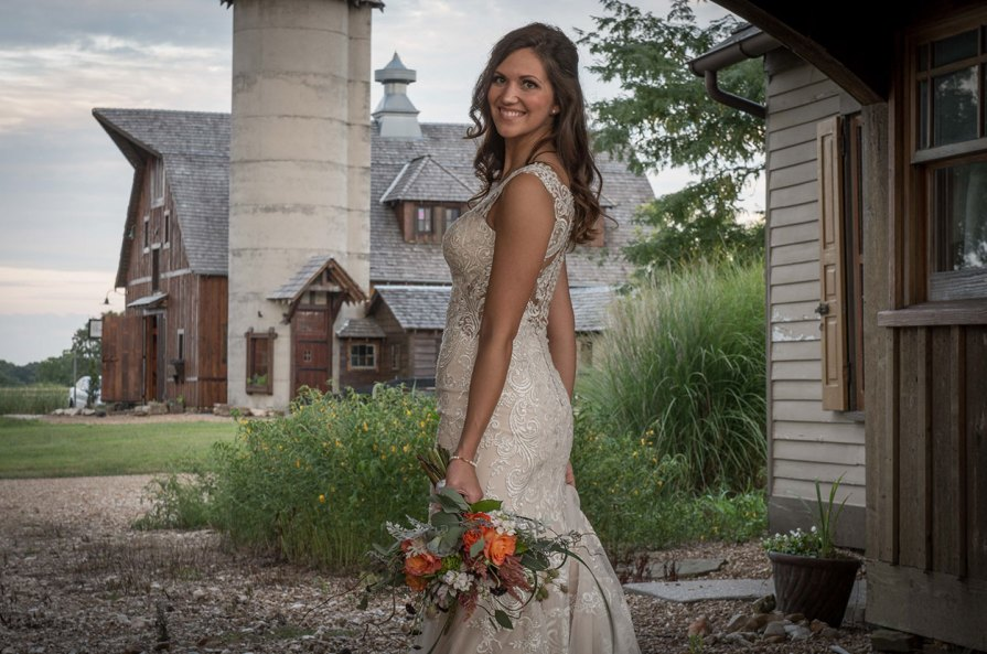 Under the arch at 'Writer's Cottage' Storybook Barn, a place where your wedding stories can come true. Pictures from a recent bridal photoshoot.Image credit: M. Shipley, 417 Photo Works