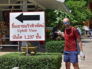 Alex at bottom of Tiger Cave Temple 1237 steps sign Krabi Thailand