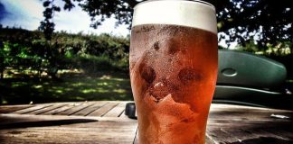 A pint of beer on an outdoor table