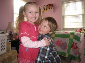 he adores his sister-age three