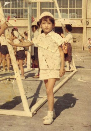 In the school playground, a young Musubu