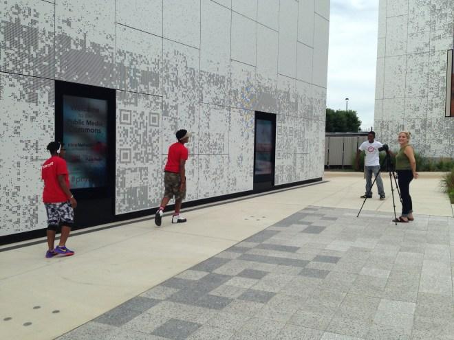 Washington University undergraduate student Charlotte Gordon collects footage of Stitchers Teens Saturday in Grand Center.