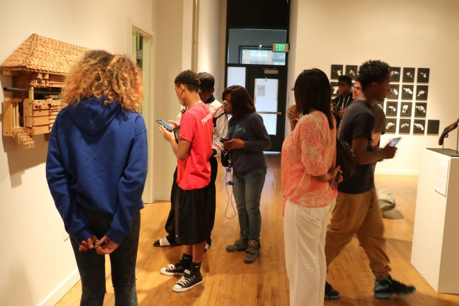 Stitchers Teens view the exhibition at Des Lee Gallery where the discussion will take place on Nov. 14th.