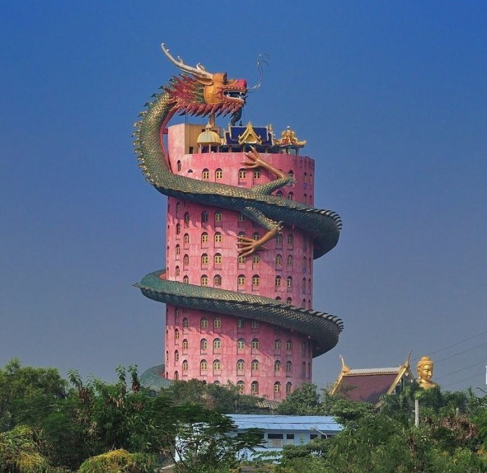 Shades of the World: A dragon sculpture wrapped around Wat Sampran's cylindrical, red building