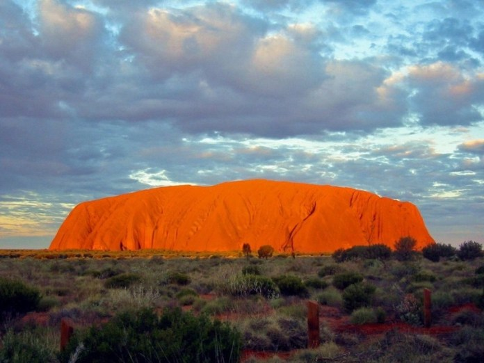 Shades of the World Series: Uluru Rock glows bright orange during sunset period