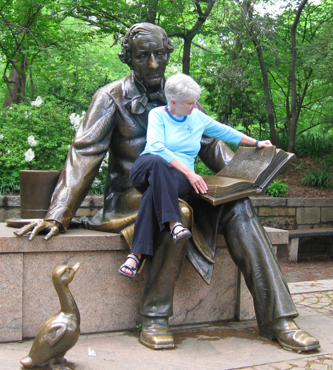 Connie reads with Hans Christian Andersen in Central Park