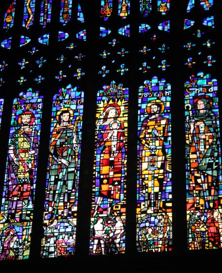 St Oswald is depicted on the left of this window at Chester Cathedral