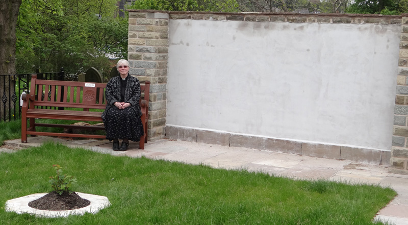 Afterwards, Veronica enjoyed a few moments relaxation on the bench presented to St Oswald's church several years ago in memory of the late Tom Young, organist and choirmaster