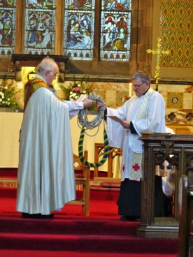 Bishop Peter gives Michael a bellrope