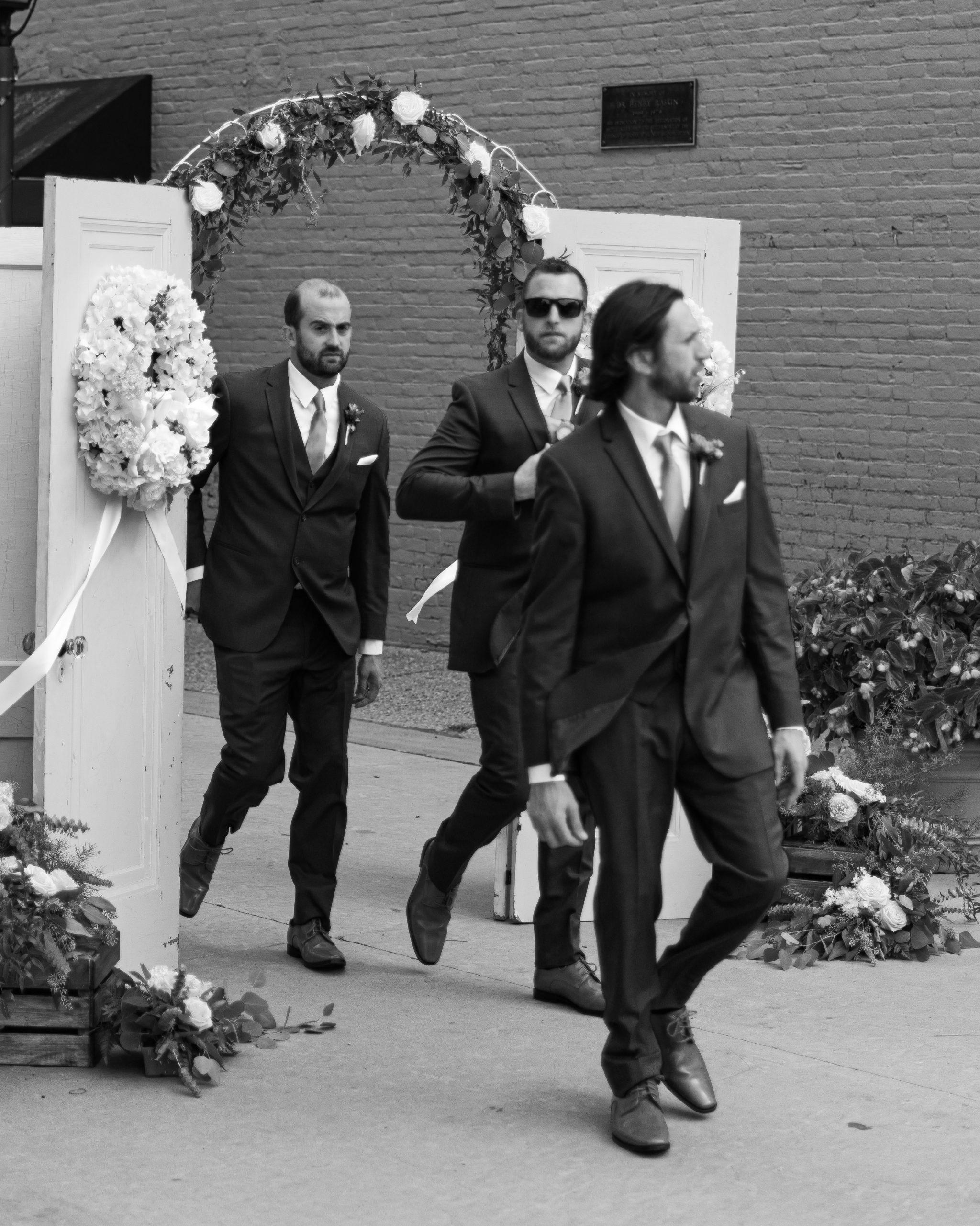 Three groomsmen in Holly for a wedding
