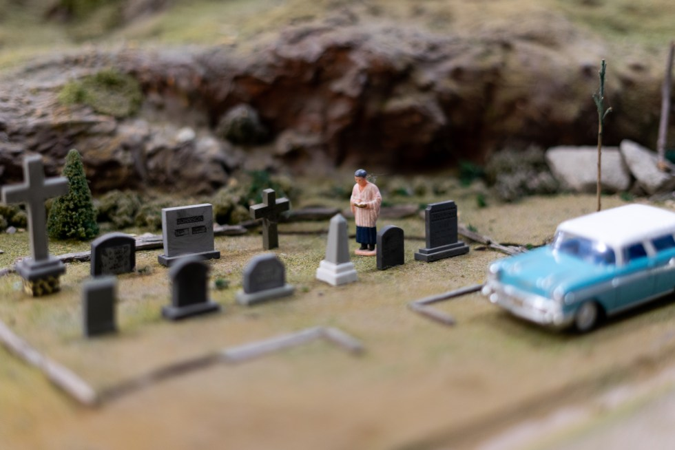 A preist in a graveyard at the Holly Railroad Club