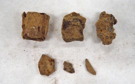The various metal and clinker pieces found in the second bag of artifacts from SU 1211.