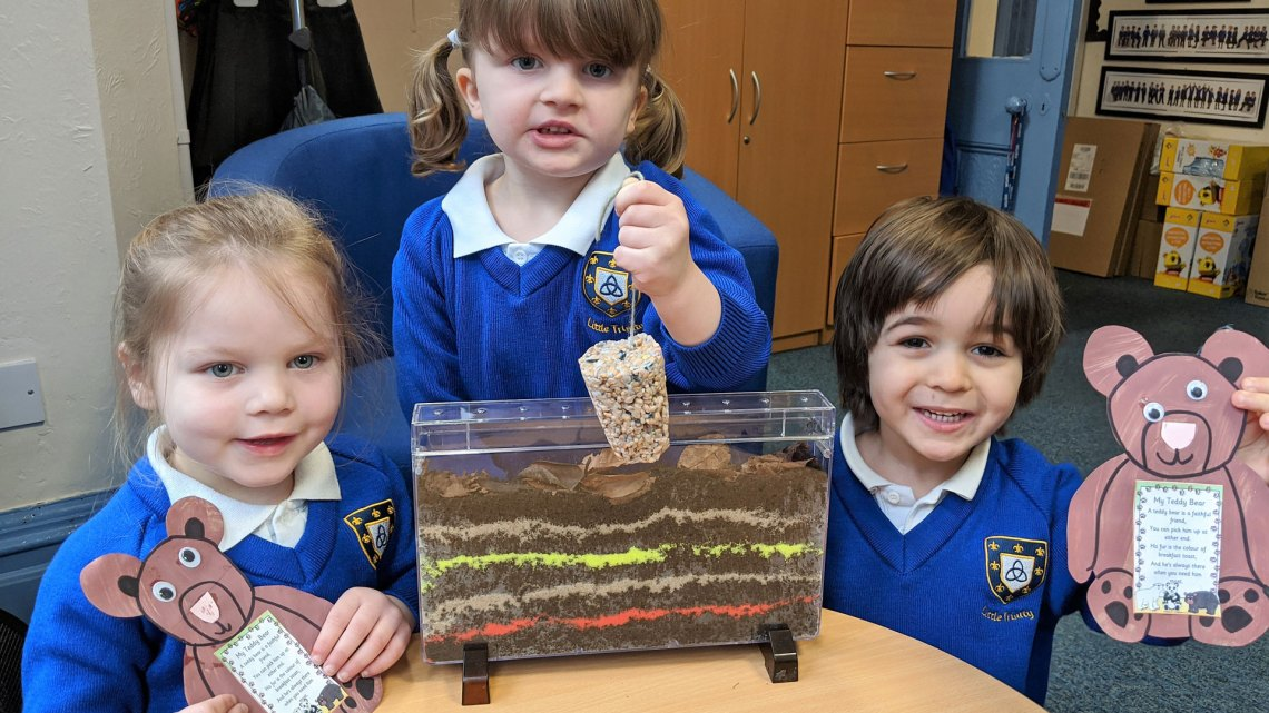 Delighted with their new ant farm, bird feeders and 'Kind Bear' drawings, 4-year old Ashleigh Crisp and 3-year olds India Foxall and Nirvana Somers.