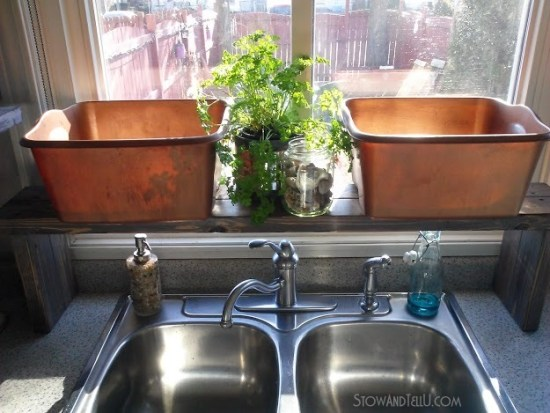 Keep a small kitchen counter de-cluttered with a diy over the kitchen sink shelf that is large enough to hold dish bins until you have time to wash the dishes from Stow and Tell U