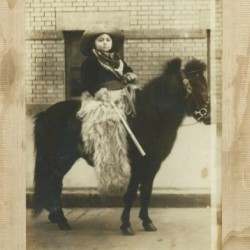 vintage-photo-picture-of-child-on-a-ponyvintage-photo-portrait-child-on-a-pony-in-western-gear