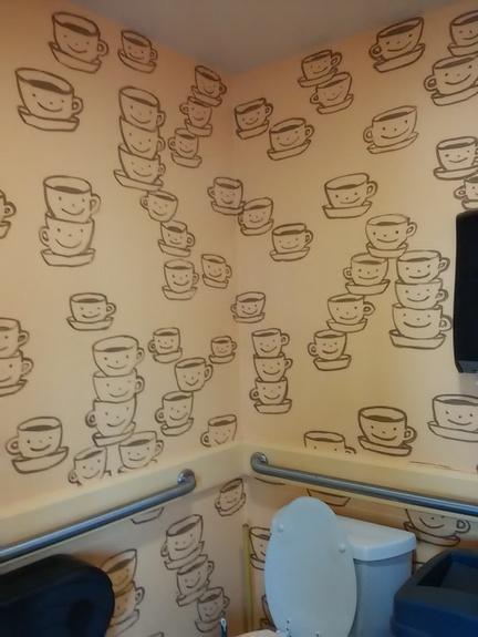 logo-on-bathroom-wall-as-decor