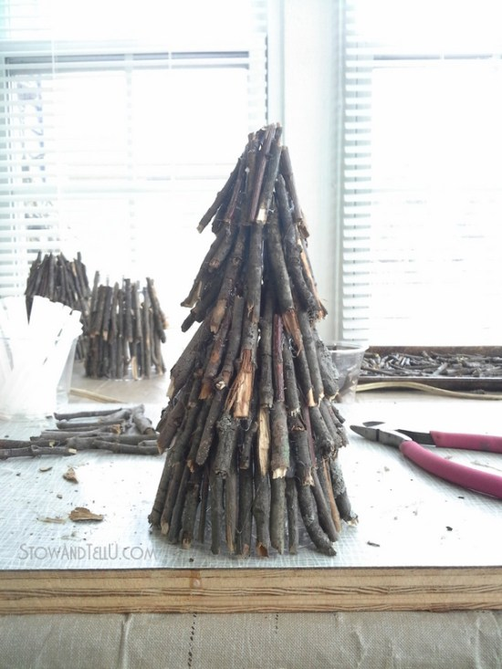 Create a rustic twig Christmas tree for holiday crafts, decor or a centerpiece with twigs, a clear plastic cup and hot glue. Can also be used as a flameless candle luminary from Stow and Tell U