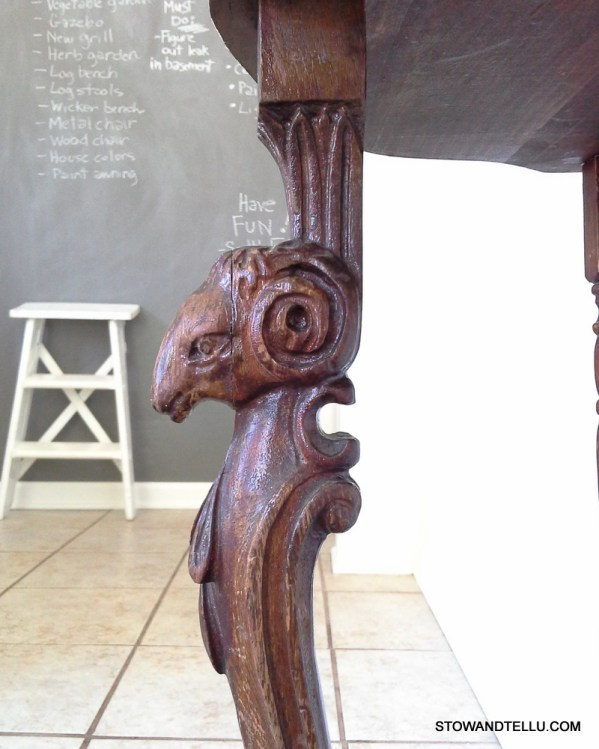 carved-ram-detail-wood-table