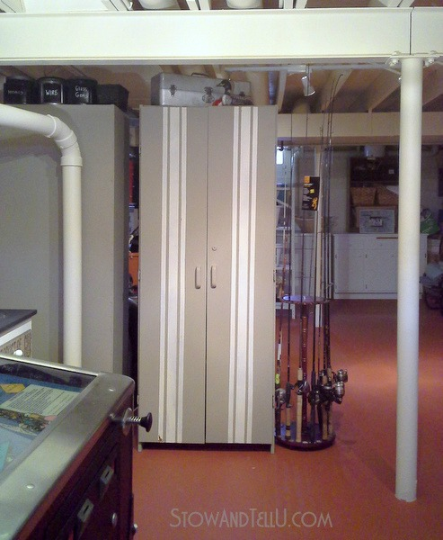 storage-cabinets-wall - open floor plan basement layout using cabinets as a wall - StowandTellU.com